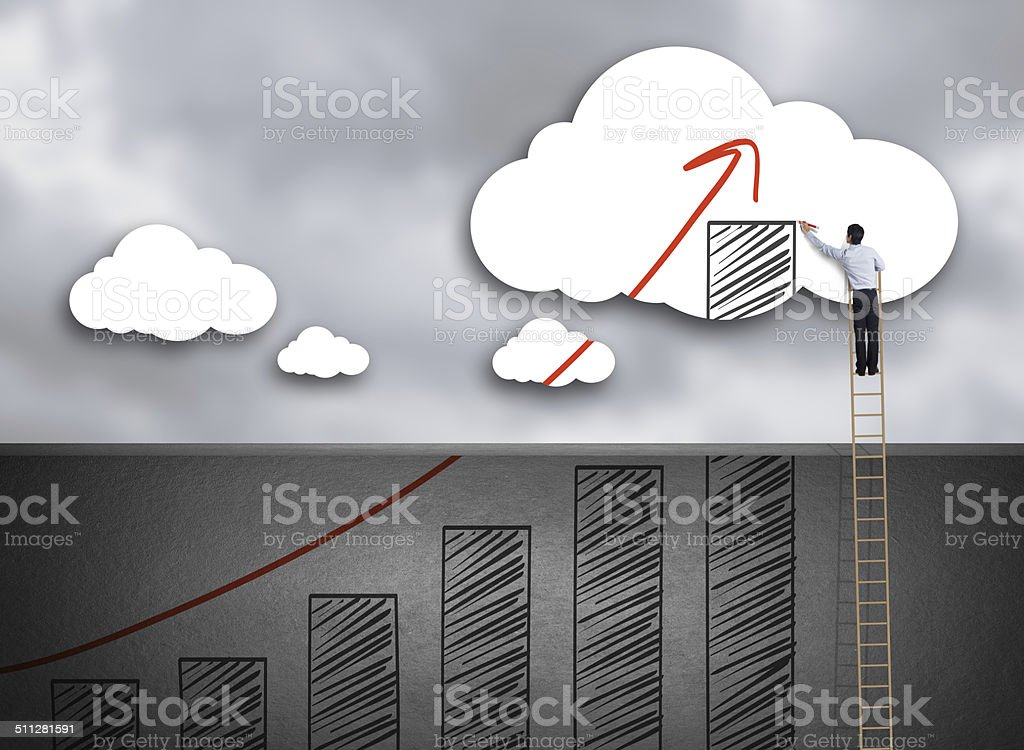 Businessman climbing ladder drawing growth chart on cloud stock photo