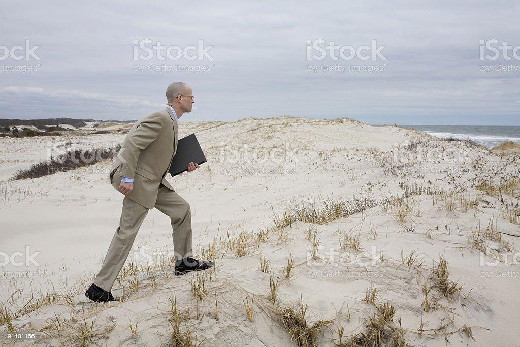 Businessman Climbing on the Sand Dune royalty-free stock photo