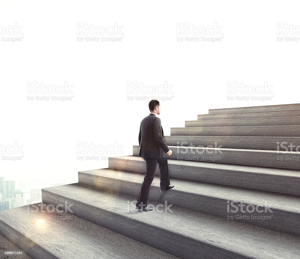 businessman climbing stock photo