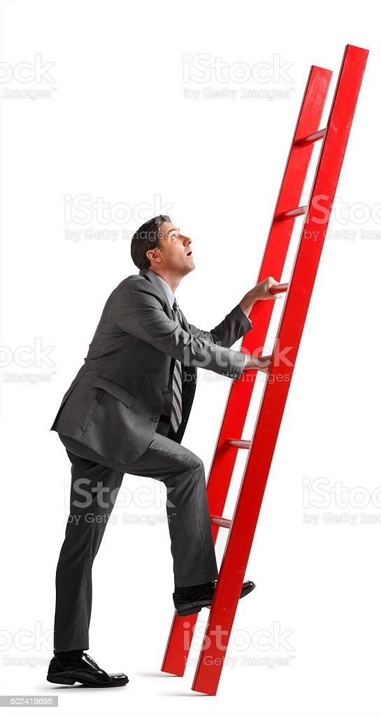 Businessman Climbing the Corporate Ladder royalty-free stock photo