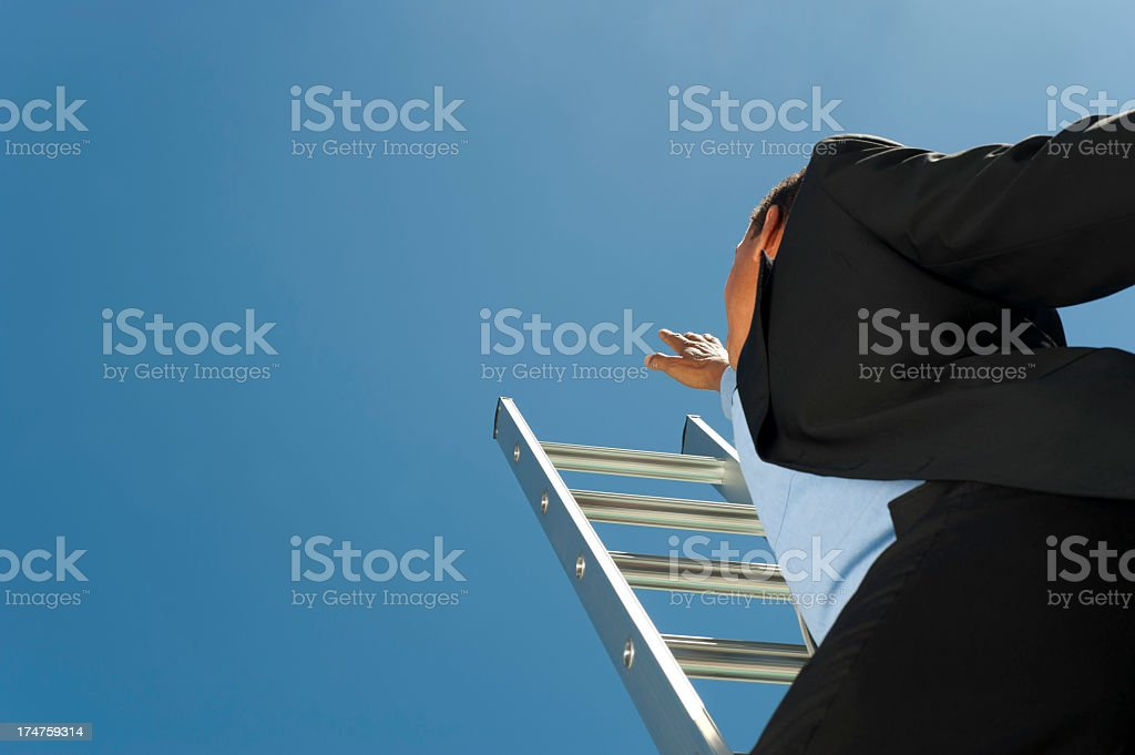 Businessman climbing the Ladder of success royalty-free stock photo