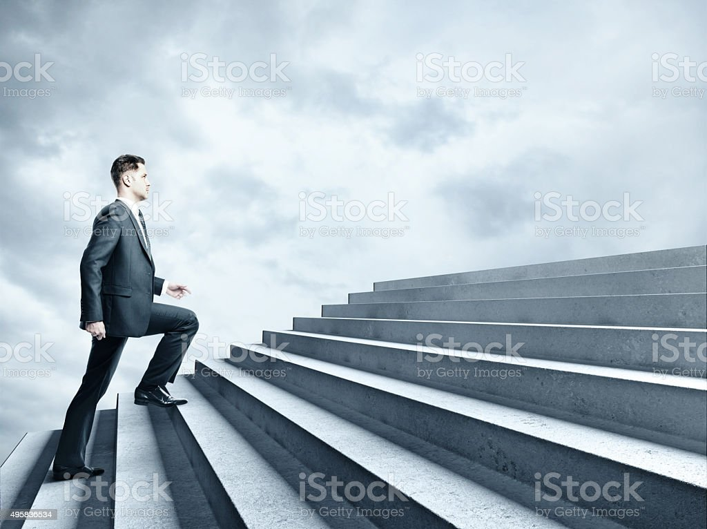 businessman climbing to stairs stock photo