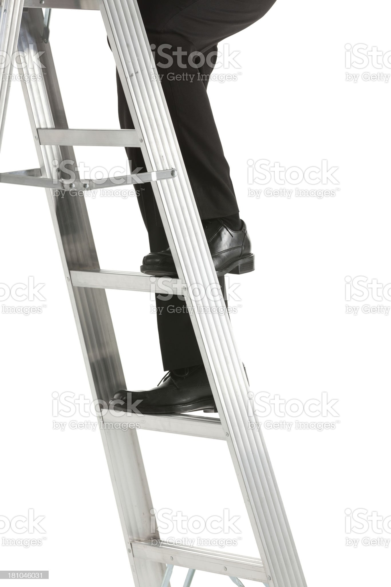 Businessman climbing up a ladder royalty-free stock photo