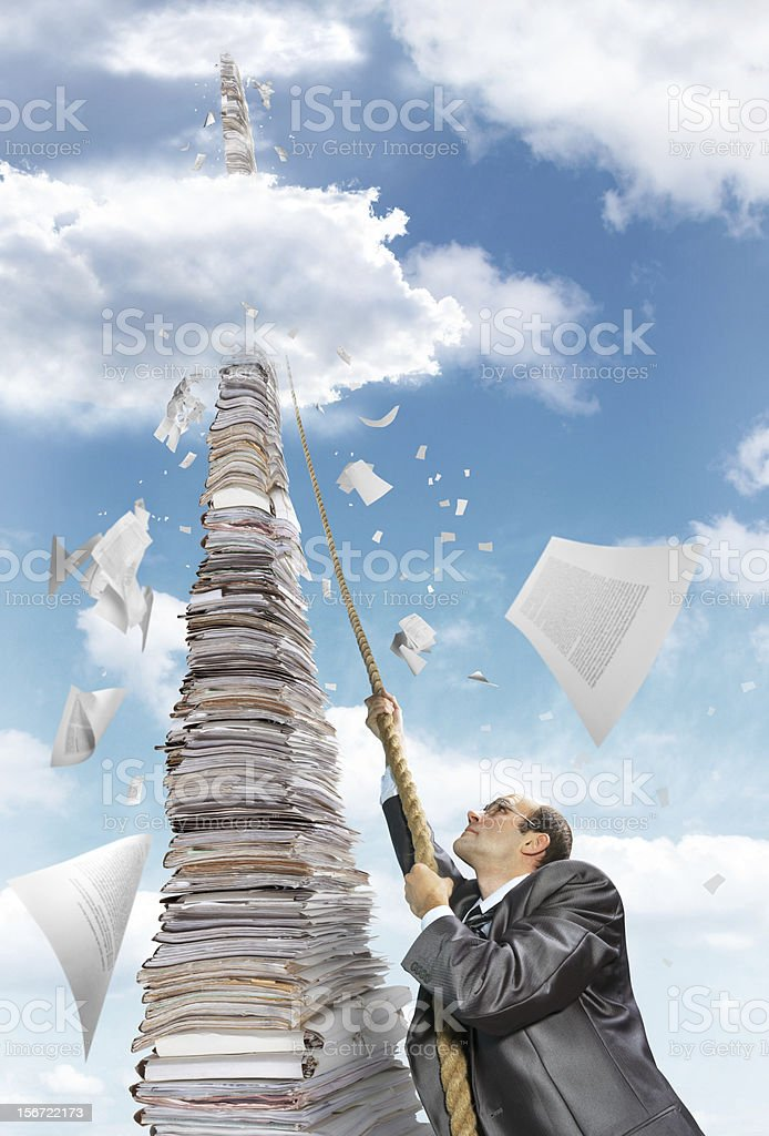 Businessman climbing up the pile of paperwork royalty-free stock photo