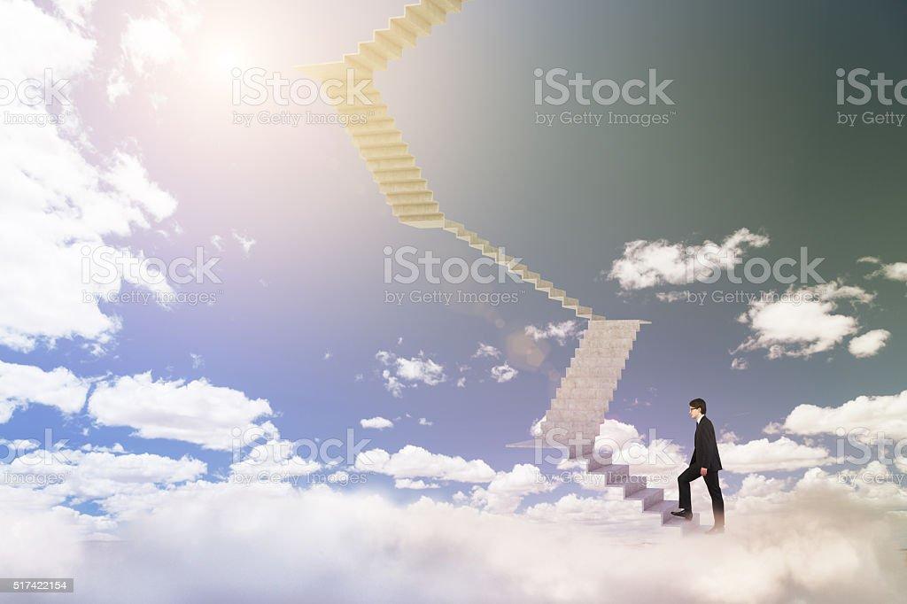 Businessman climbing upstairs stock photo