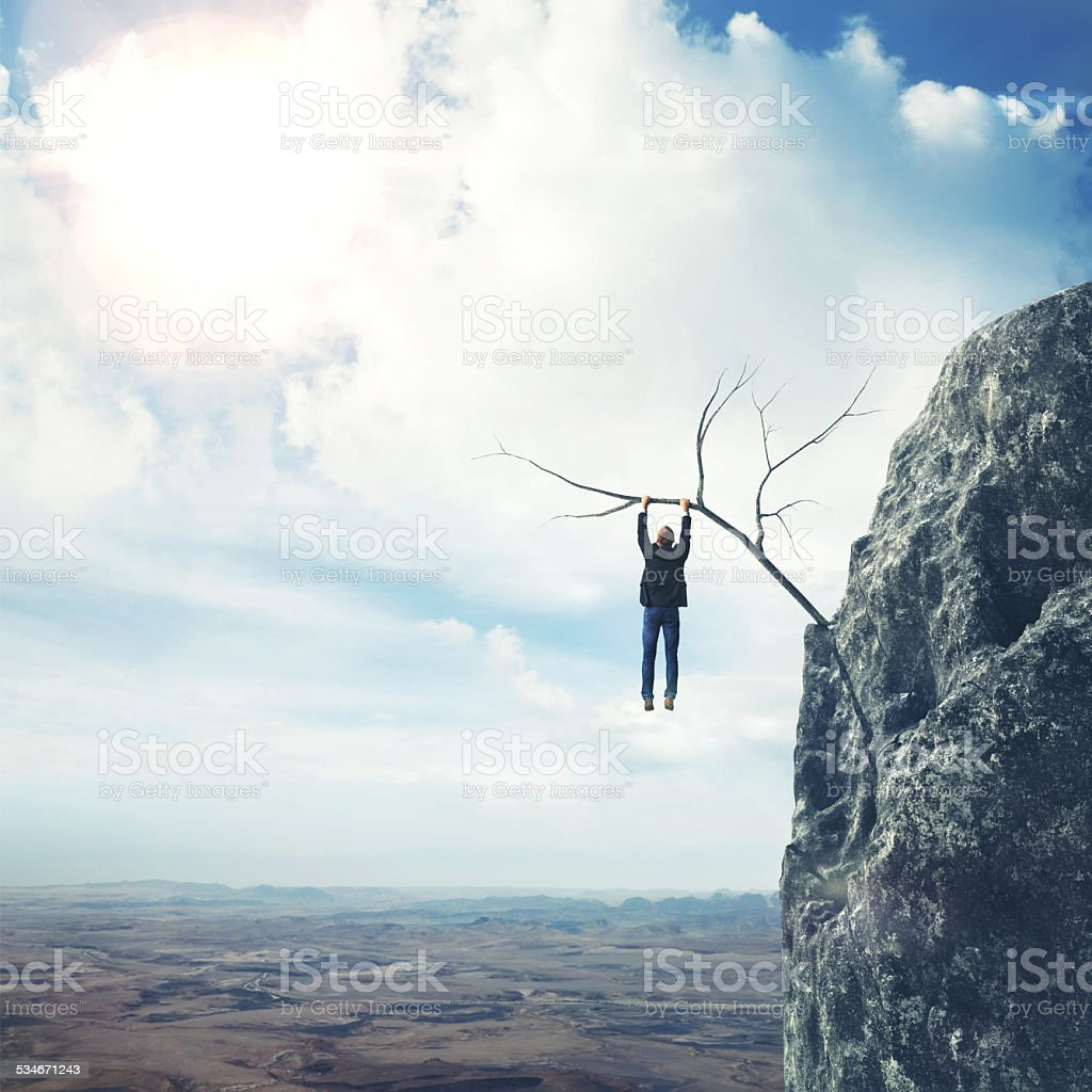 Businessman climbs a mountain stock photo
