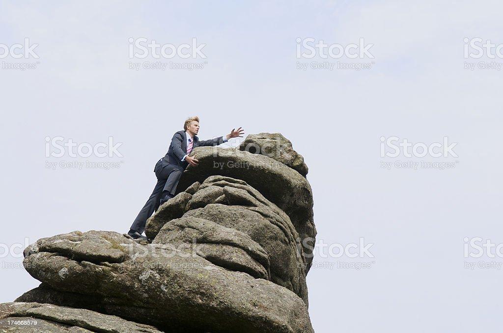 Businessman Climbs to the Peak royalty-free stock photo