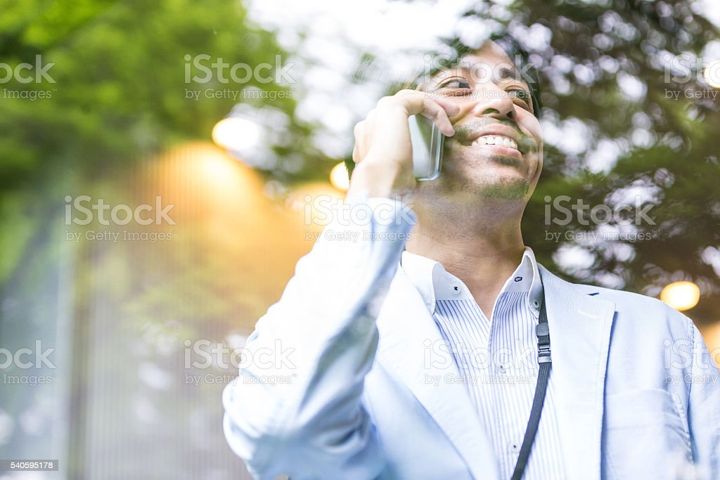 Businessman closing another deal on the phone call stock photo