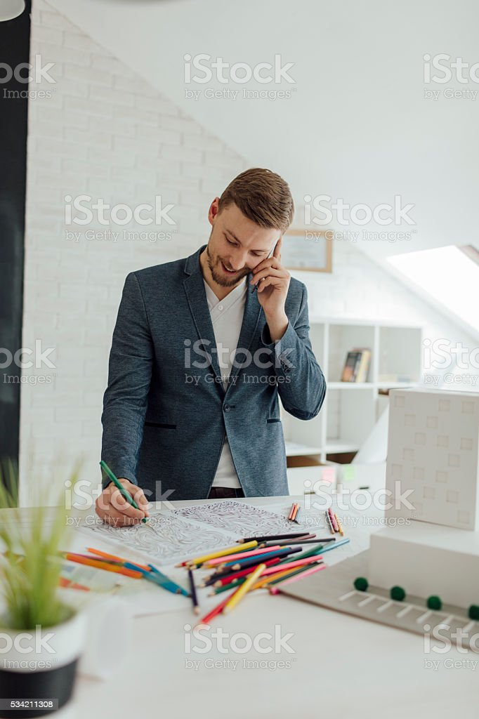 Businessman Coloring Book In His Office. stock photo