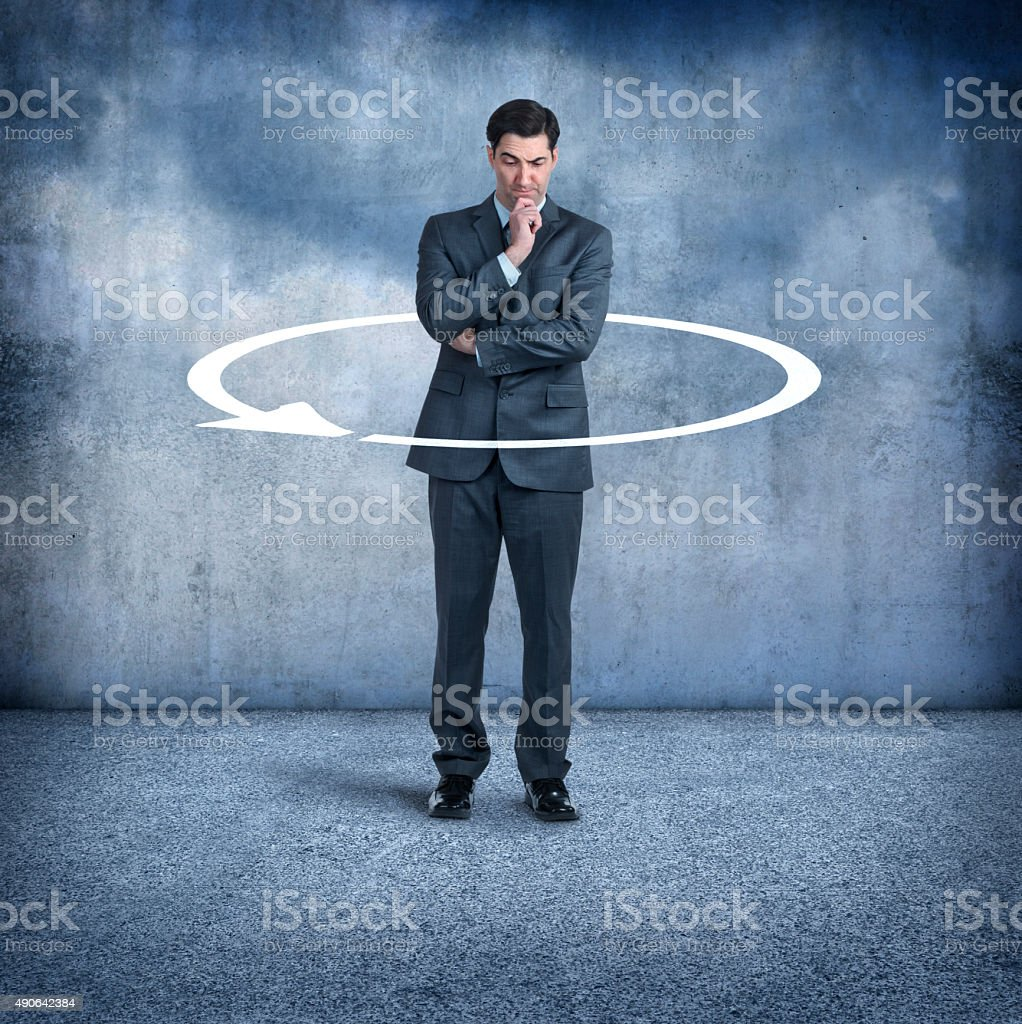 Businessman Coming Full Circle stock photo