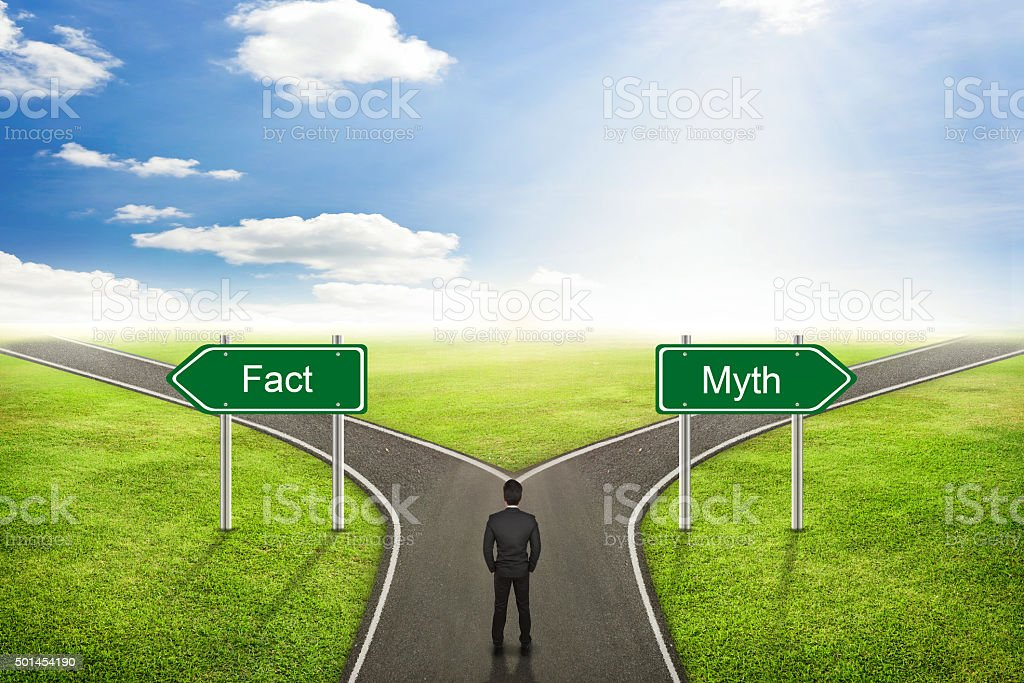 Businessman concept; choose Fact or Myth road the correct way. stock photo