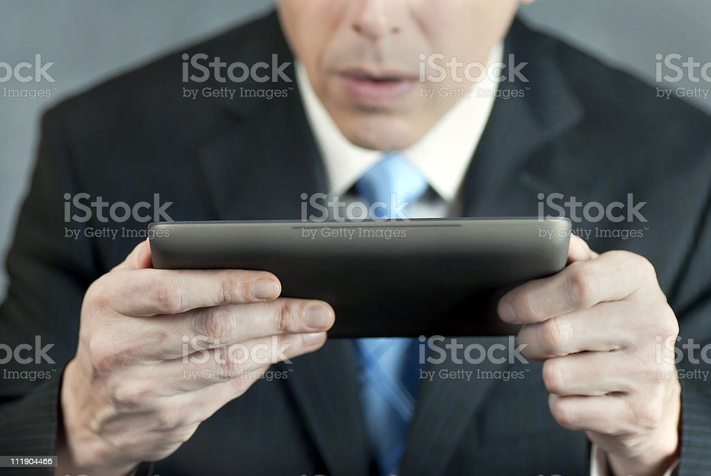 Businessman Concerned By Tablet royalty-free stock photo