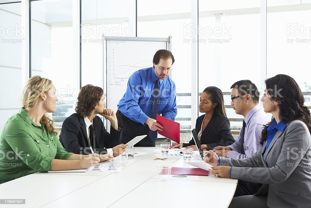 Businessman Conducting Meeting In Boardroom royalty-free stock photo