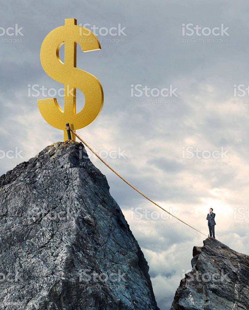 Businessman Considering The Risk Od A Financial Payoff stock photo