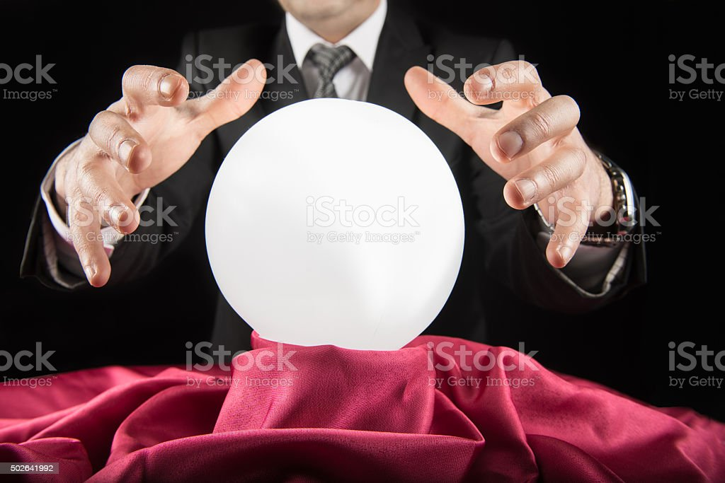 Businessman Consulting Financial Crystal Ball stock photo