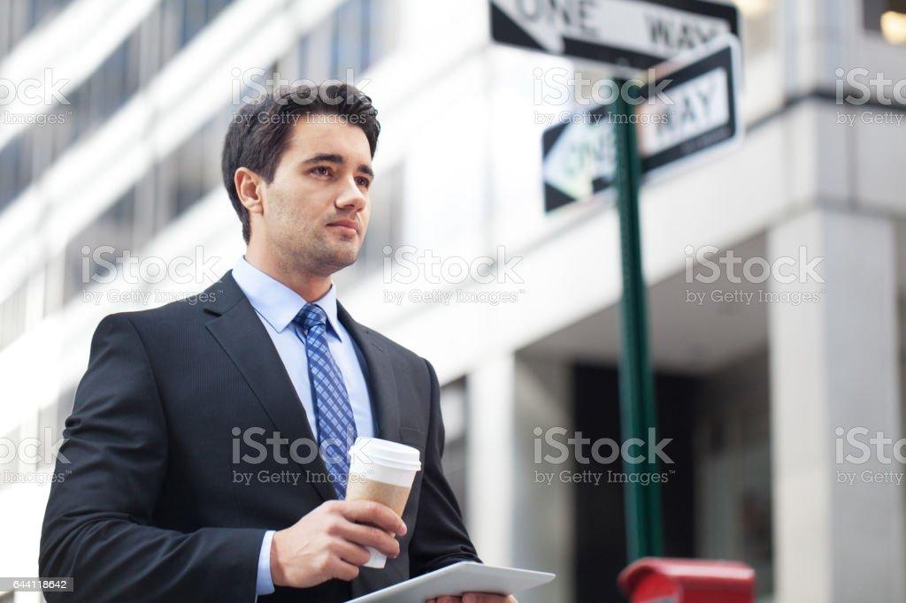 Businessman contemplating his career stock photo