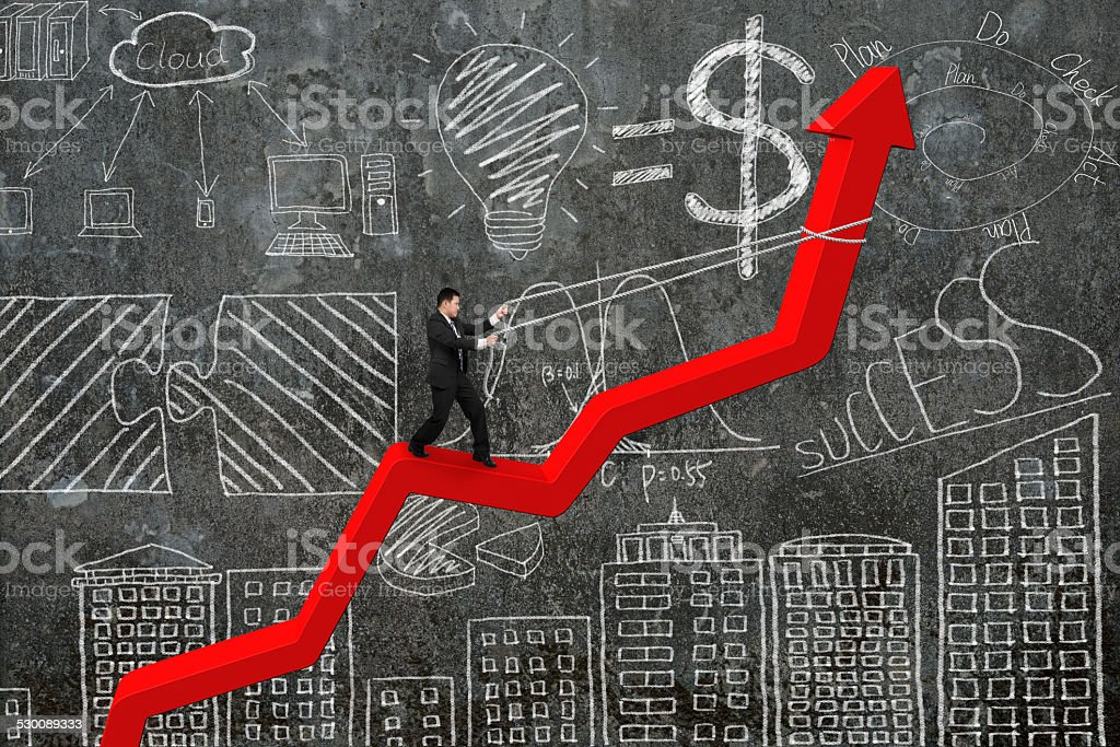 Businessman control arrow direction of red trend line with doodl stock photo