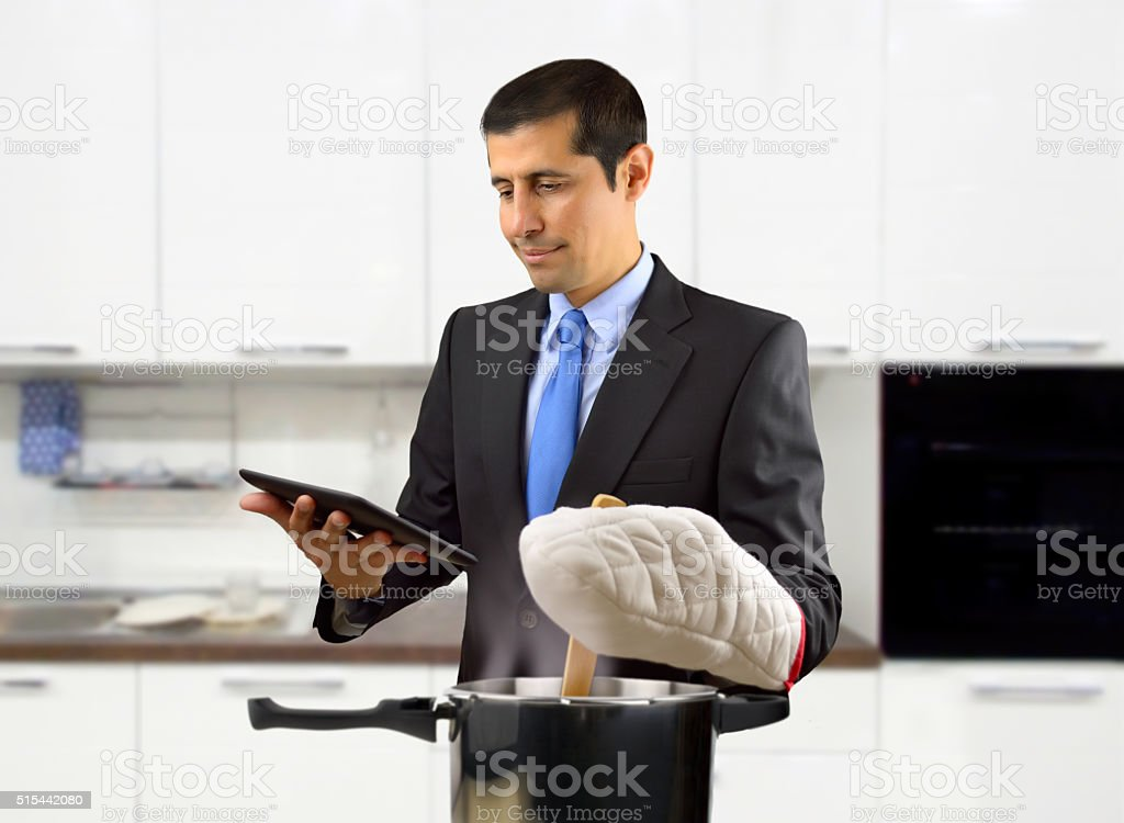 businessman cooking stock photo
