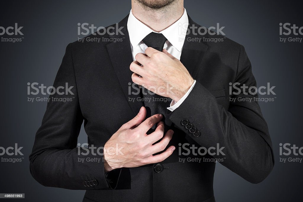 businessman correcting tie stock photo