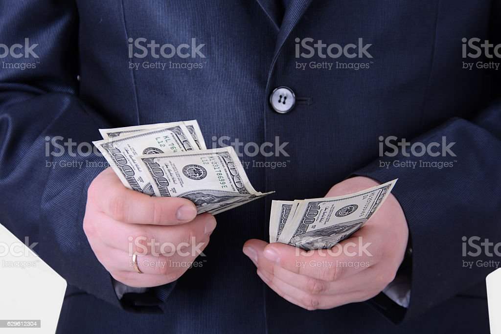 Businessman counting money on a white background stock photo