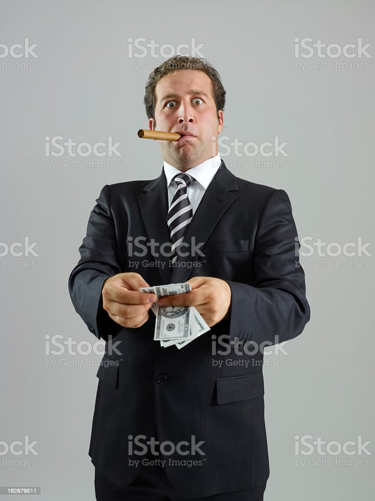 Businessman Counting Money royalty-free stock photo