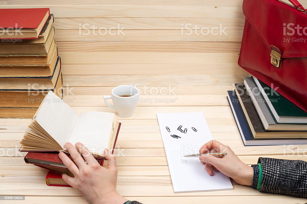 Businessman counting profit and losses, analyzing financial results. stock photo
