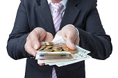 Businessman cover growing money.