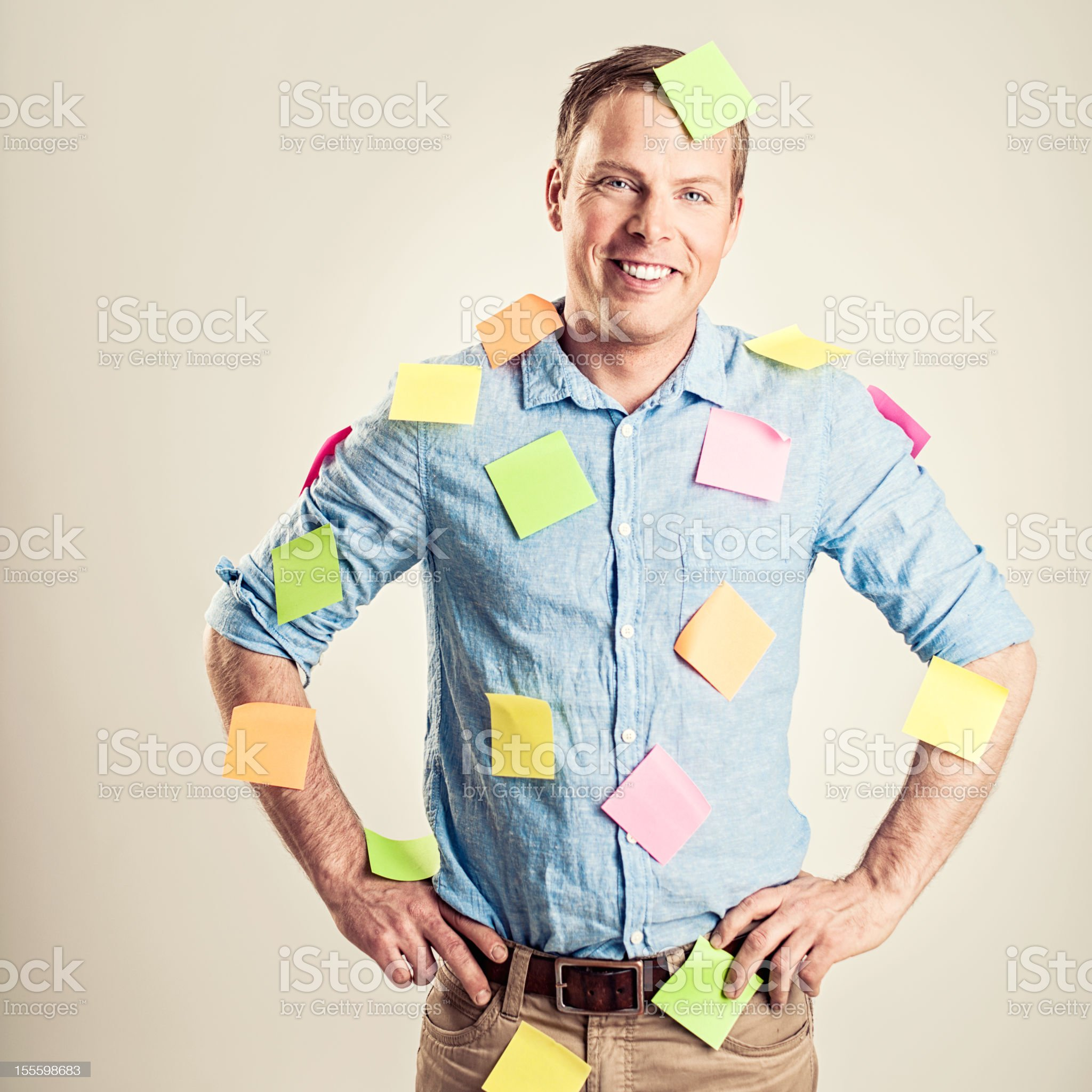 Businessman covered in notes royalty-free stock photo