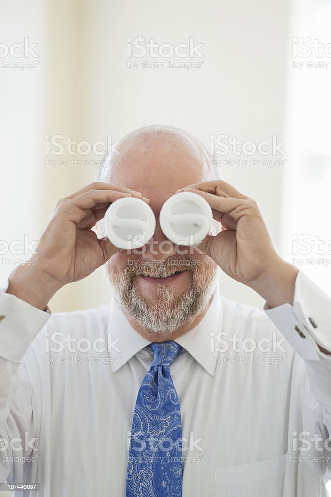 Businessman Covering Eyes With Light bulbs royalty-free stock photo