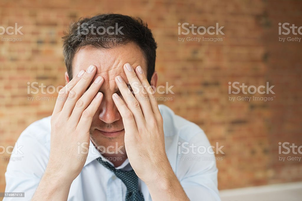 Businessman Covering Face With Hands royalty-free stock photo