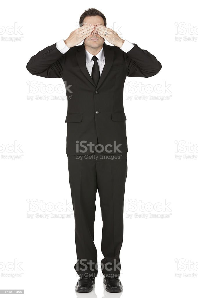 Businessman covering his eyes royalty-free stock photo