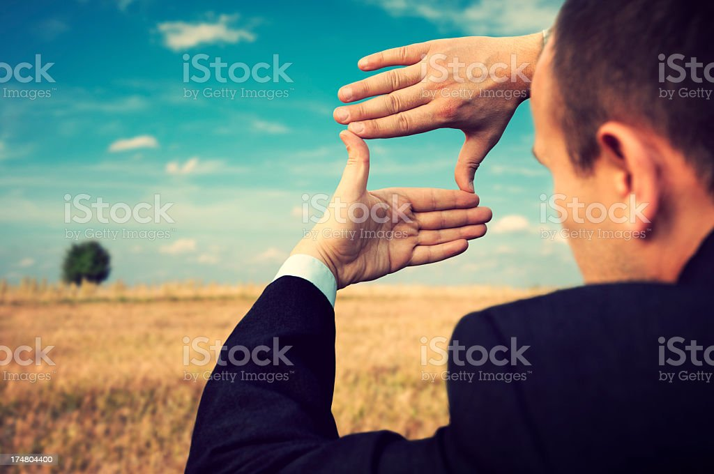 Businessman creates a composition of hand. stock photo