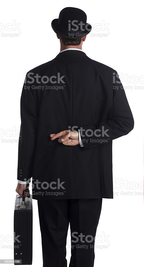 Businessman Crossing his Fingers stock photo