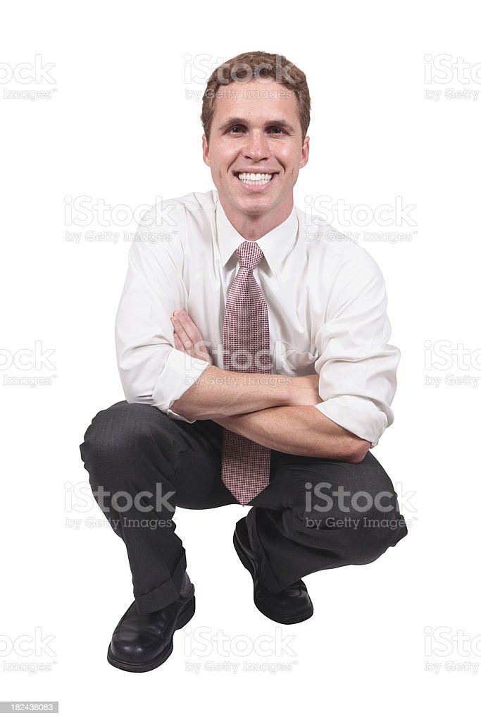 Businessman crouching down arms folded royalty-free stock photo