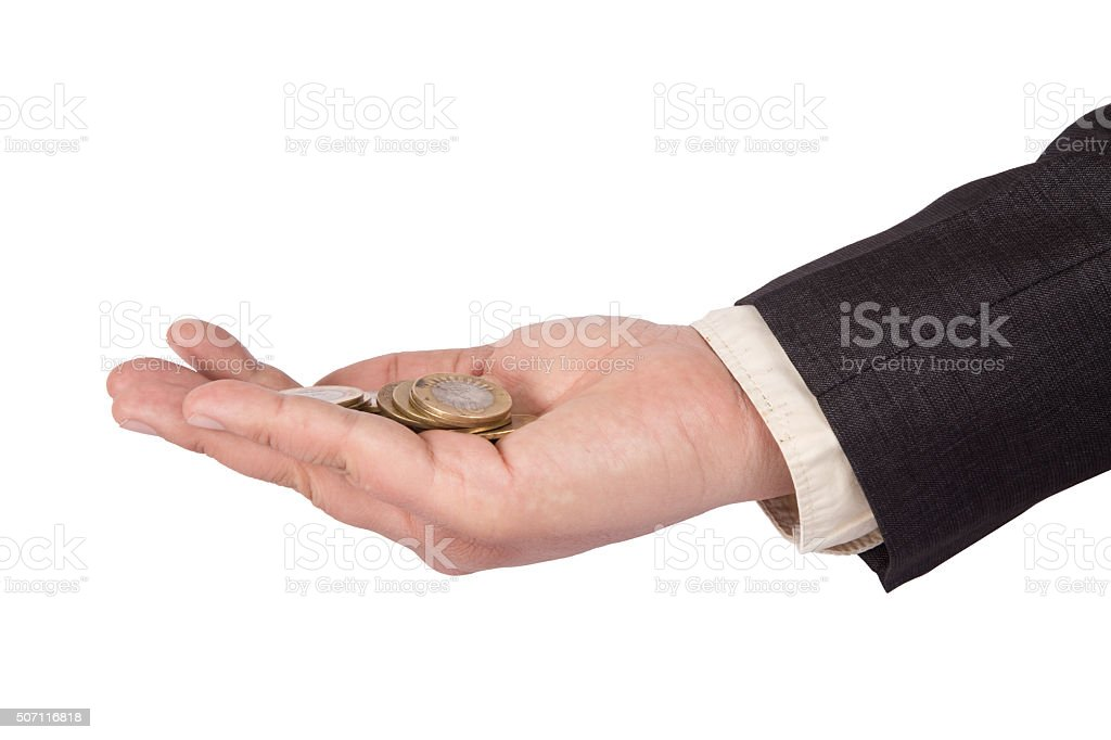 Businessman cupping hands with coins stock photo