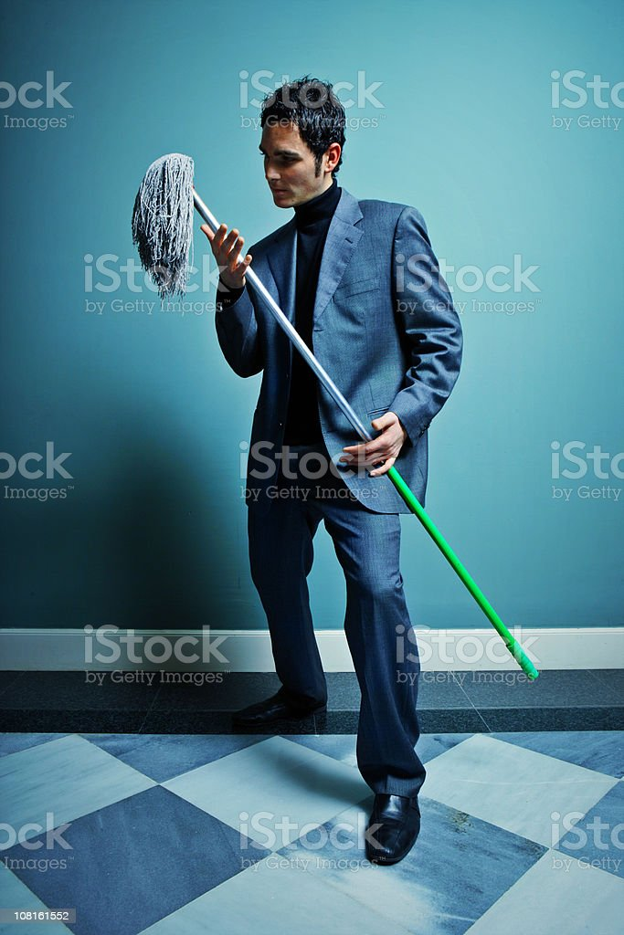 Businessman Dancing with a Mop stock photo