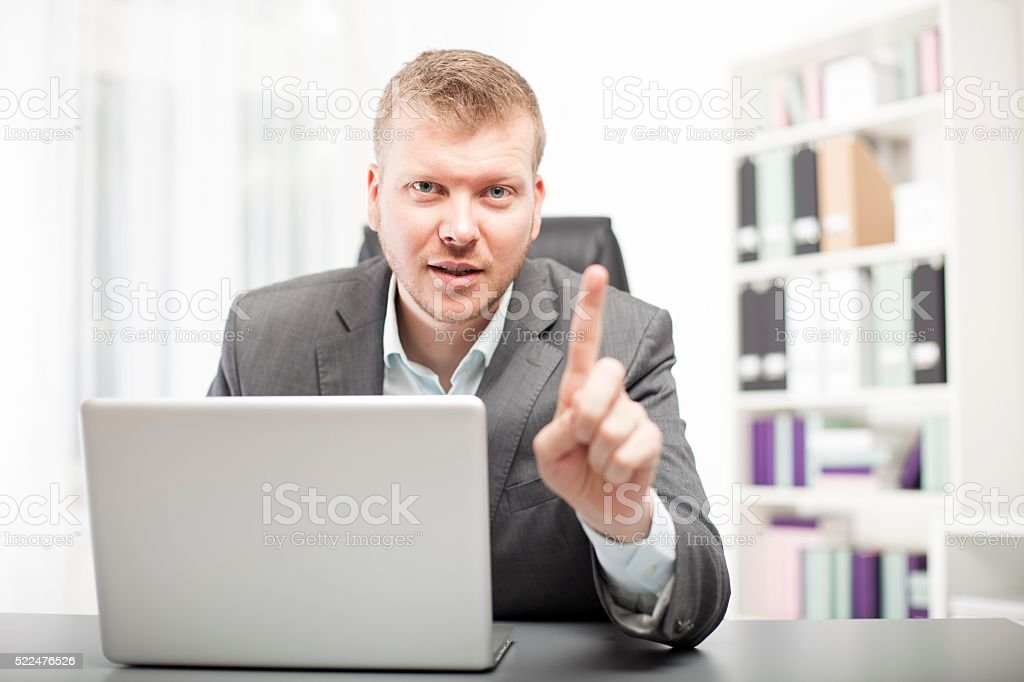 Businessman delivering a lecture to a client stock photo