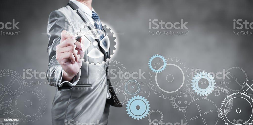 Businessman design gear, business strategy concept stock photo