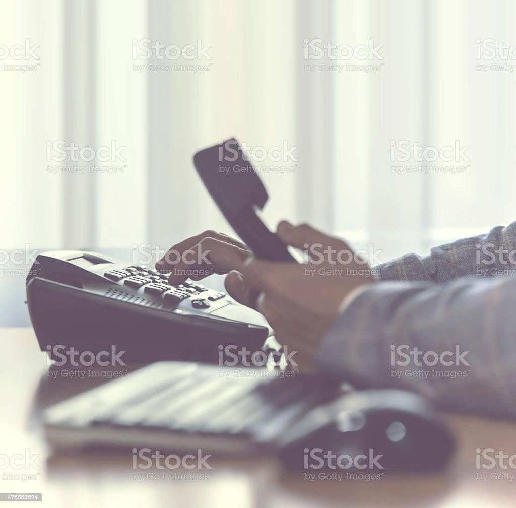 businessman dialing phone stock photo