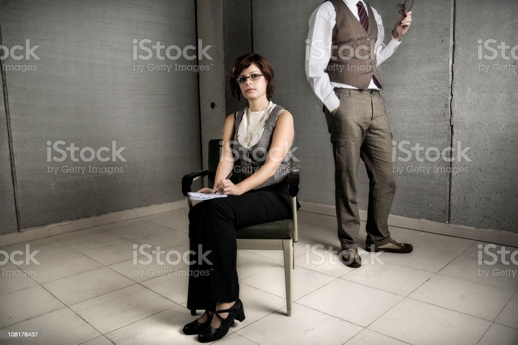 Businessman Dictating to Secretary Woman Taking Notes stock photo