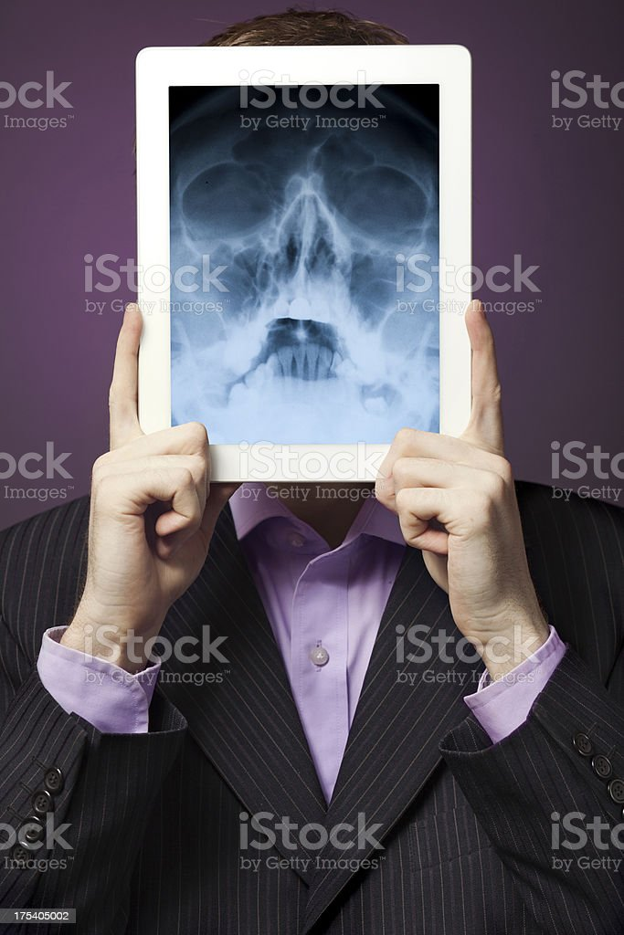 Businessman, Digital Tablet and X-ray royalty-free stock photo