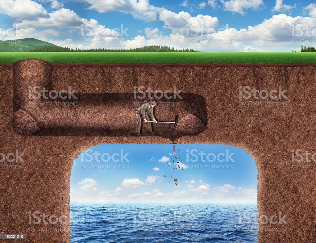 Businessman digs a tunnel stock photo