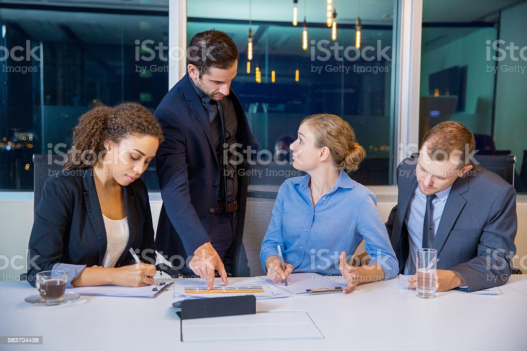 Businessman Discussing Business with Team stock photo