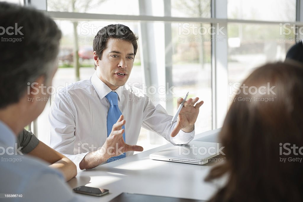 Businessman Discussing New Ideas With Colleagues stock photo