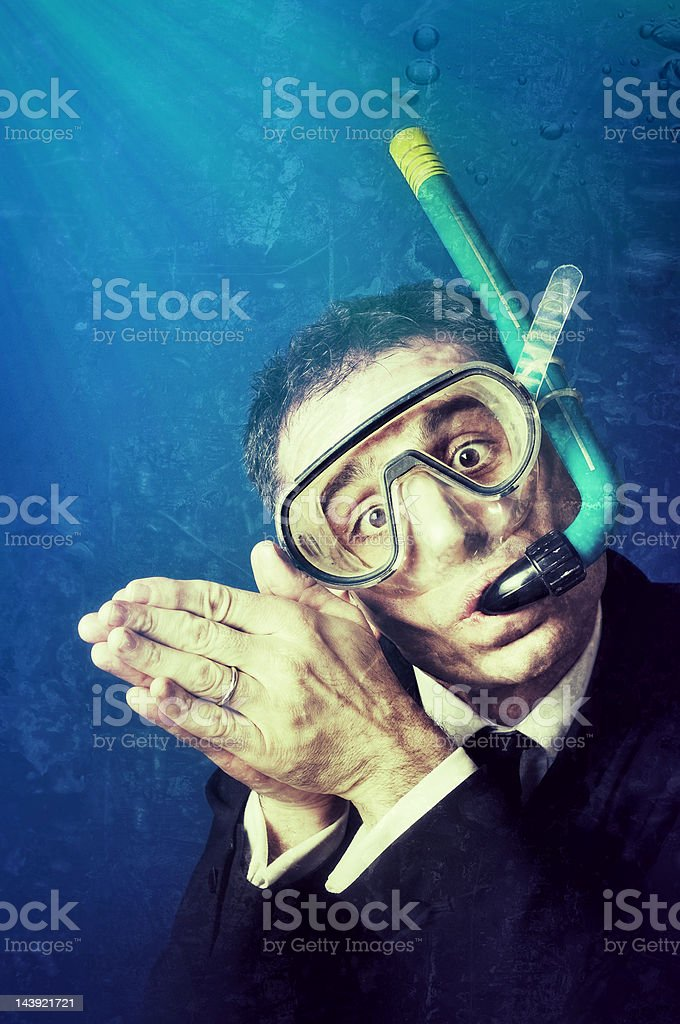 Businessman Diving in a deep sea. Vintage style stock photo