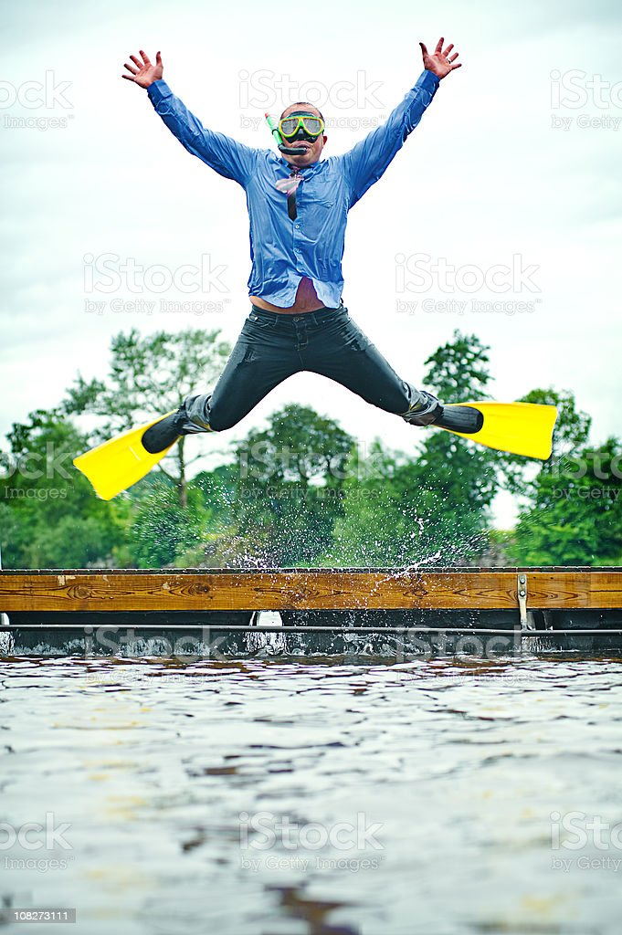 Businessman diving into water stock photo