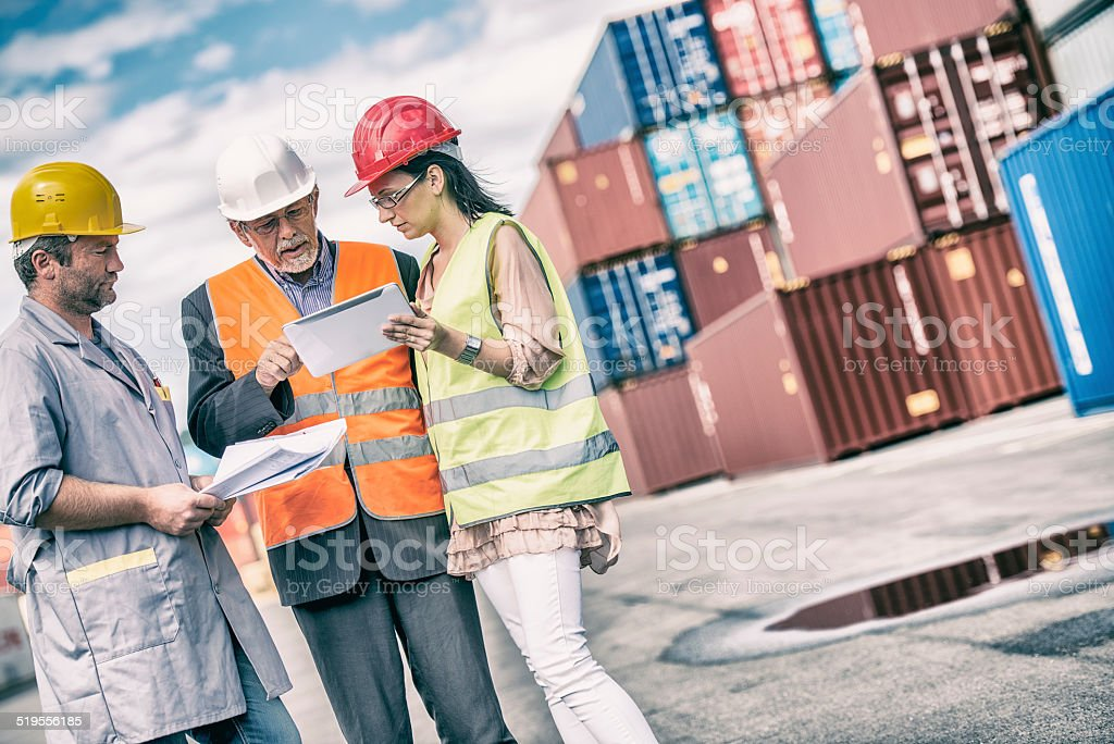 Businessman, Dock worker and inspector stock photo