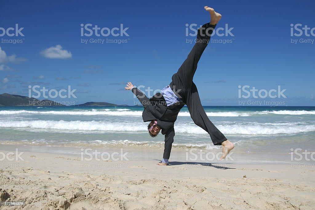 Businessman Does Cartwheel on Beach royalty-free stock photo