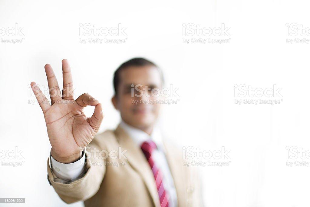 Businessman doing an ok hand sign stock photo