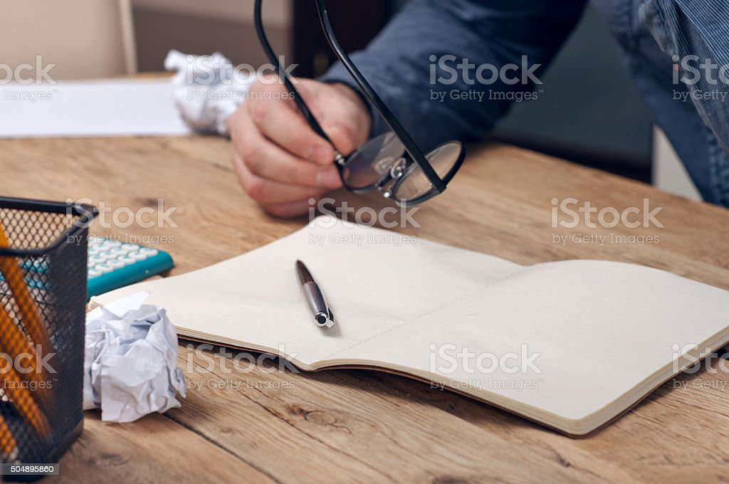Businessman doing finances on a wooden table stock photo